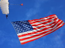 American flag. And parachute in the sky Royalty Free Stock Photos