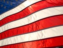 American flag. Billowing in the wind back lit by sun Stock Photo