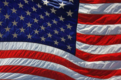 American flag. Flying in the wind close-up Stock Photo