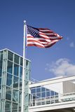 American Flag. In front of modern building royalty free stock photography