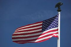 American Flag. Stars and stripes with eagle on the flagpole Stock Images