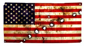 American flag. Grungy American Flag perforated, bullet holes, isolated against white background Stock Photo