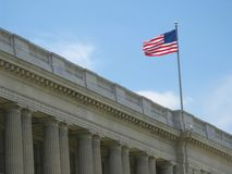 American flag above building Stock Image