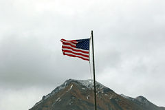 American Flag Above a Mountain Peak Royalty Free Stock Photography