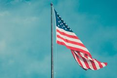 American flag against blue skies Royalty Free Stock Photography