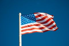 American flag against blue sky Stock Photos