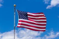 American Flag Against Blue Sky.  Stock Photo
