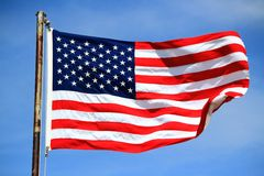 American Flag Against Blue Sky Royalty Free Stock Photo