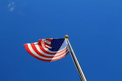 American flag against clear blue sky Royalty Free Stock Images