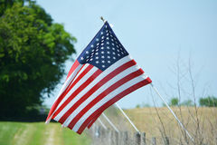American Flag against field Royalty Free Stock Image
