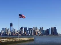 American flag against Manhattan skyline stock photos