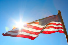 American flag against the sun Royalty Free Stock Photos