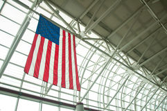 American Flag in Airport. American flag hanging from the ceiling of the Charlotte/Douglas International Airport building in Charlotte, North Carolina (USA Royalty Free Stock Image