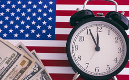 American flag, alarm clock and dollars Stock Image