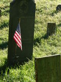 American flag in ancient graveyard Stock Photography