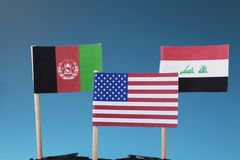 American flag and another two flags of Afghanistan and Iraq. The States where america has his soldiers. stock photos