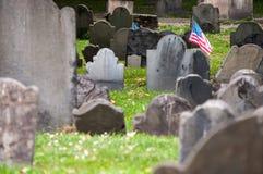 Granary Burying Ground, Boston. American flag attached to a grave in the Granary Burying Ground in Boston Royalty Free Stock Photos