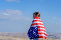 Patriotic holiday. Happy kid, cute little child girl with American flag. USA celebrate 4th of July. royalty free stock photo