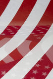 American Flag Background. An american flag abstract background. Reflections of stripes and stars in the foreground stock image
