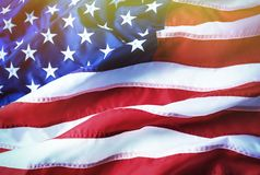 American flag background. Brightly lit American flag. Sunlight, sunflare. US flag stock image