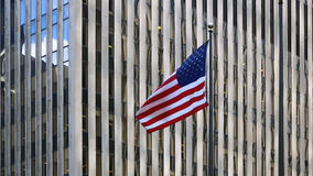 American flag on a background of a building. American flag fluttering in the wind against a building in New York City. American flag on the background of a stock video