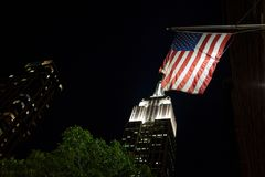 American flag on the background of the Empire State Building stock photography