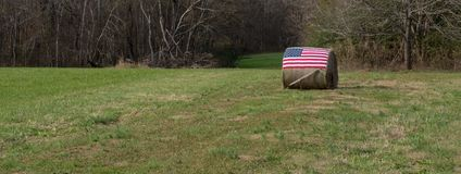 American flag on bale of hay stock image