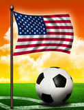 American flag and ball. On soccer field Royalty Free Stock Photo