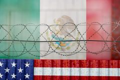 USA Mexico border wall. American flag and barbed wire, USA Mexico border wall royalty free stock images