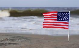American Flag on Beach Stock Photo