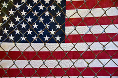 American flag behind fence Stock Image