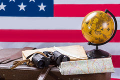 American flag behind globe. Royalty Free Stock Images
