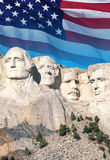 American flag behind Mount Rushmore Royalty Free Stock Photography