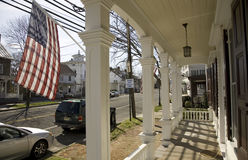 American flag being displayed on porch of home. On Main Street of Vincentown, New Jersey Stock Images