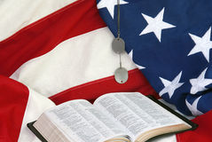 American Flag with Bible. Stitched American flag with Bible and WWII dog tags stock photography
