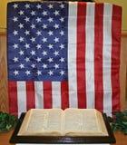 American flag and bible. Display of american flag and bible on table Stock Photos