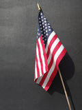 American Flag on Black Chalkboard Background. An American flag against a blank, black background royalty free stock photos