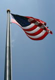 American Flag Blowing. An American flag blowing proudly in the wind Royalty Free Stock Images