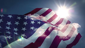 American flag blowing against blue sky. Digital animation  American flag blowing against blue sky stock video footage
