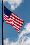 American Flag Blowing Against Cloudy Sky Royalty Free Stock Photo