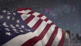 American flag blowing against fireworks. Digital composite of American flag blowing against fireworks stock video footage