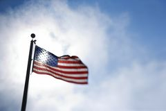 American flag blowing in breeze. Stock Photos