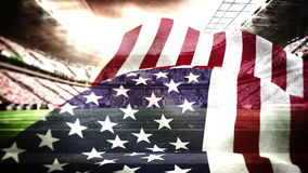 American flag blowing in football stadium. Digital animation of American flag blowing in football stadium stock video footage