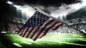 American flag blowing in football stadium stock footage