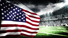 American flag blowing in football stadium stock video footage