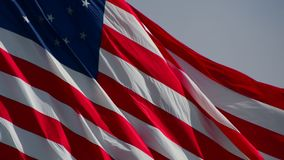 American. The American flag blowing in the wind stock footage