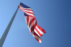 American flag blowing in wind Royalty Free Stock Photos