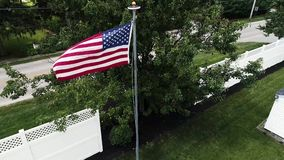 American Flag blowing in the wind, in 4K by Drone. American Flag blowing and waving in the wind, in 4K by Drone in USA stock footage