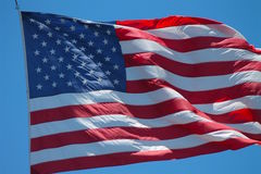 American Flag Blowing in Wind Stock Image
