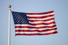 American flag blows in the wind by the ocean in Newport, Rhode Island Stock Photo